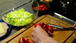 man prepares salad - man sliced pepper Footage