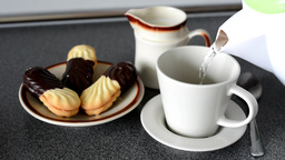 preparation of coffee in home - milk and cookies (sweets) Footage