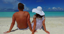 v14870 two 2 people sitting together a romantic young couple on a tropical Footage