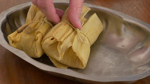 Filling a tray with tamales for serving side shot Footage
