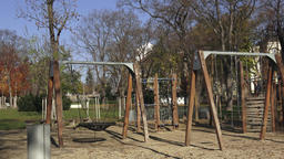 Children playground activities in public park surrounded by trees Filmmaterial