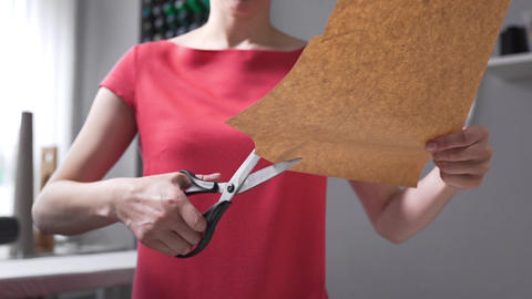 Scissors cut paper, seamstress cuts patterns befor seawing, clothes cutting Live Action