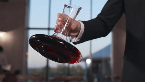Barman shakes the wine in a decanter in slow motion, 240 frames per second Footage