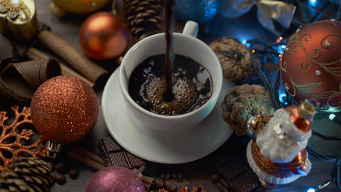 Cup of hot coffee with cinnamon sticks on wooden table among Christmas Archivo
