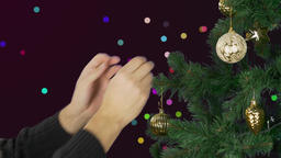 Mans hand decorate christmas tree. Abstract background. Sparkle glow shine Footage