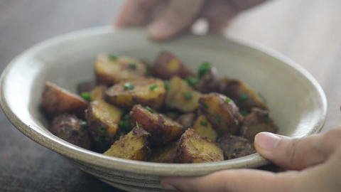 Serving delicious roasted potatoes Live Action