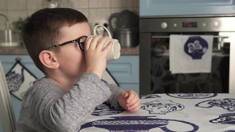 Little boy is drinking milk and smiling Footage