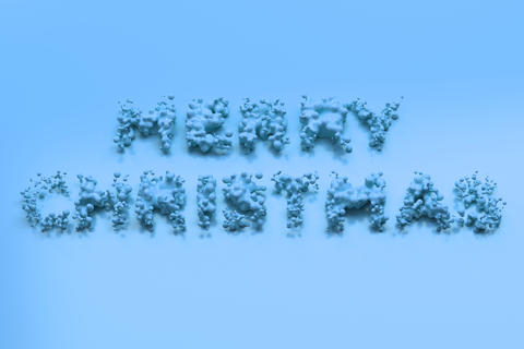 Liquid blue Merry Christmas words with drops on blue background フォト