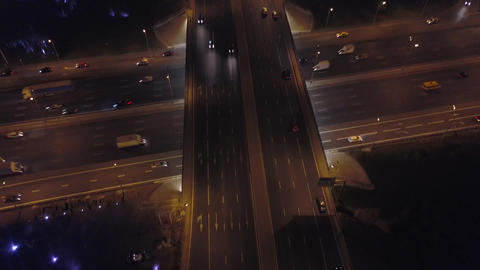 Aerial: Flyover of Moscow beltway with moving cars and evening cityscape Footage