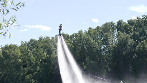 Man hovers high above using water under pressure Footage