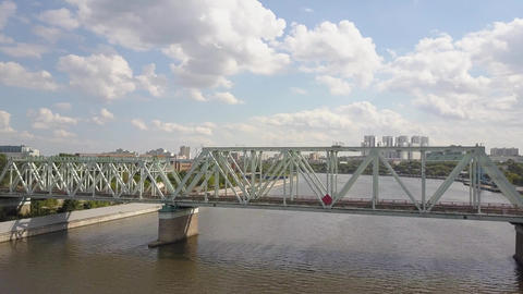 Danilovsky railway Bridge across the Moskva River against blue sky with clouds Footage