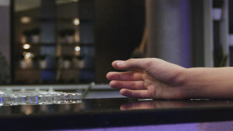 Slow Motion Person Hand Grabs Moving Glass with Whisky in Cafe Live Action