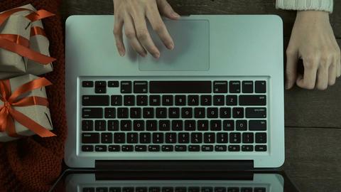 Female using laptop for send e-mail greetings on wooden desk In Christmas ライブ動画