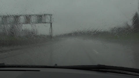 Driving in bad weather conditions. View through the windshield Footage