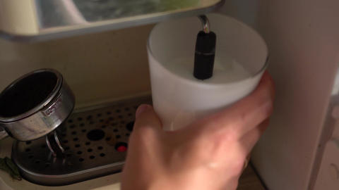 Steaming and frothing milk with coffee machine for cappuccino Footage