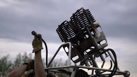Assembling hot air baloon double burner, preparation for flight. Handheld shot Footage
