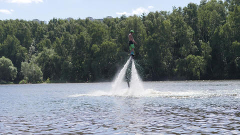 Man hovers over water and spins around with flyboard Footage