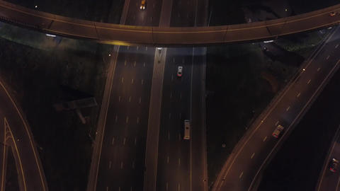 Aerial: Traffic on flyover of Moscow beltway and night cityscape Footage