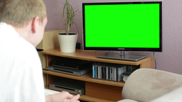 Man watches TV(television) - green screen - man laughs Footage