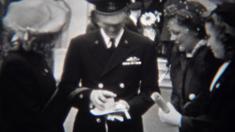 1943: Military soldier opening watch gift for valorous service during war Footage