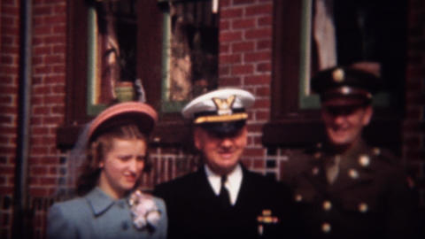 1944: Military men in decorated uniforms with new wife in proper lady attire Footage
