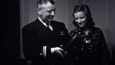 1944: Military General Inspects Modern Film Projector Technology Device stock footage