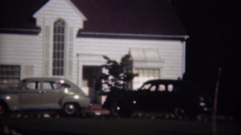 1946: Classic cars parked at fancy white wealthy home shining in sun Live Action