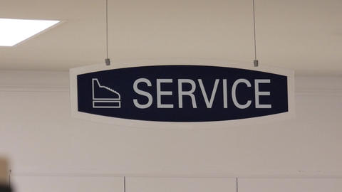 Motion of service sign hanging up the roof inside sears store with 4k resolution Footage