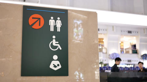 Motion of man, woman and disable washroom logo on wall with 4k resolution Footage
