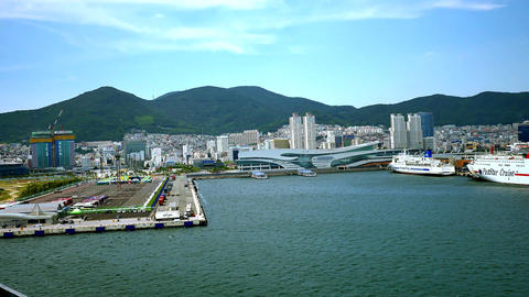wide shot of cruise ship arriving at busan port of korea Filmmaterial