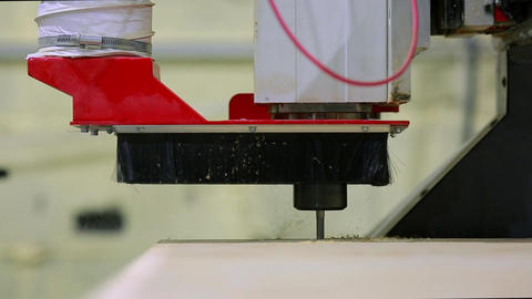 Close-up, milling machine automatically moves on the surface of the wood and Archivo