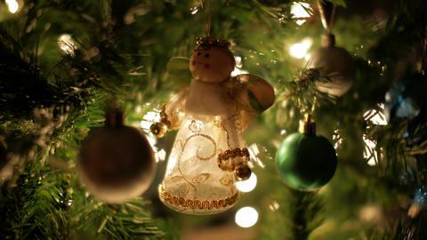 Christmas decoration on Christmas tree with illuminated bokeh lights Bild