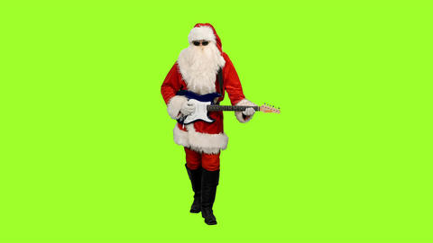 Santa Сlaus stepping and playing guitar on green screen background 画像