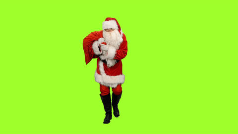 Santa carrying gifts in sack on green background, Chroma key Footage
