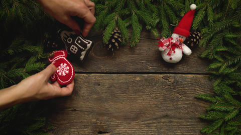 Women's hands create a Christmas decor. Christmas tree branches with cones and Footage