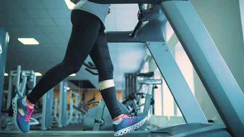 Woman running on treadmill in gym. Slow motion Footage