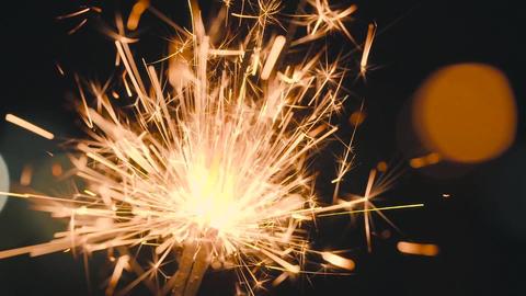 Christmas sparkler burning on a black. Slow motion Archivo