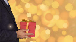 Caucasian businessman hold and give red gift box. Adult man in classic business Footage