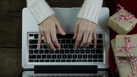 Woman use laptop computer on wood desk in Christmas day ライブ動画