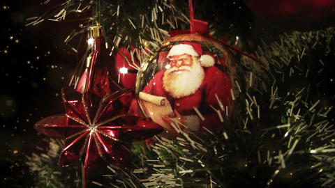 Detail of decorated Christmas tree at night, blurry lights, gold stars Animation