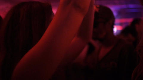 Slow Motion Girl Dances Takes Pleasure in Band Performance Footage