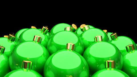 Looping 3D animation of green Christmas balls Animation