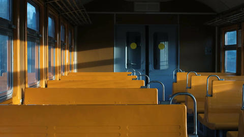 rays of light shimmer in an empty car with yellow seats Filmmaterial