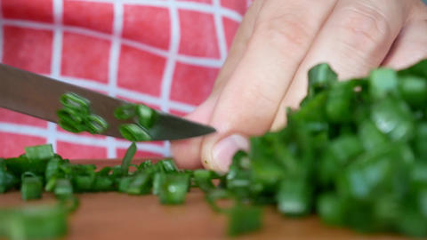 Person cutting green onions Footage