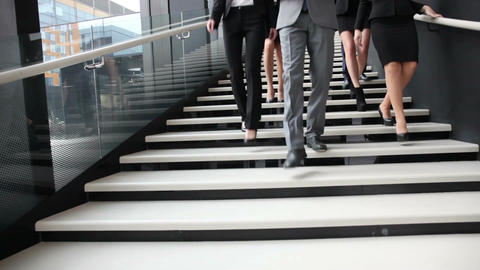Group of business people walking at stairs Footage