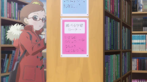 Junior high school girl reading a picture book in the school library Footage