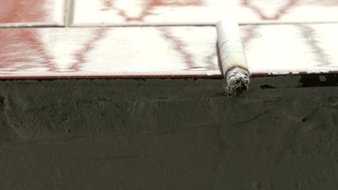 Lit cigarette on ledge 1 Footage