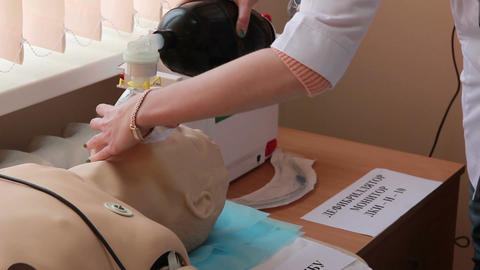 the interns studying a administer artificial respiration(artificial respiration) Live Action