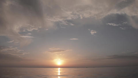 Sunrise at the seashore which float a few fishing boats 7 Footage