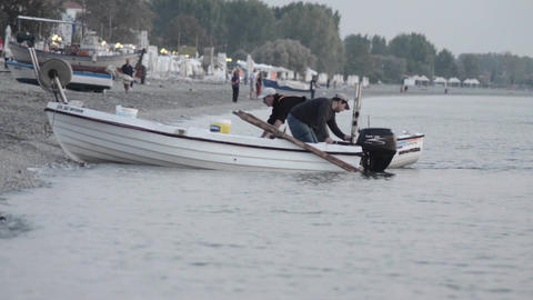 Fishermen pull their boats ashore after a day spent to fisheries at sea 9 Footage